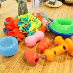 A selection of dog enrichment toys of various sizes and colors