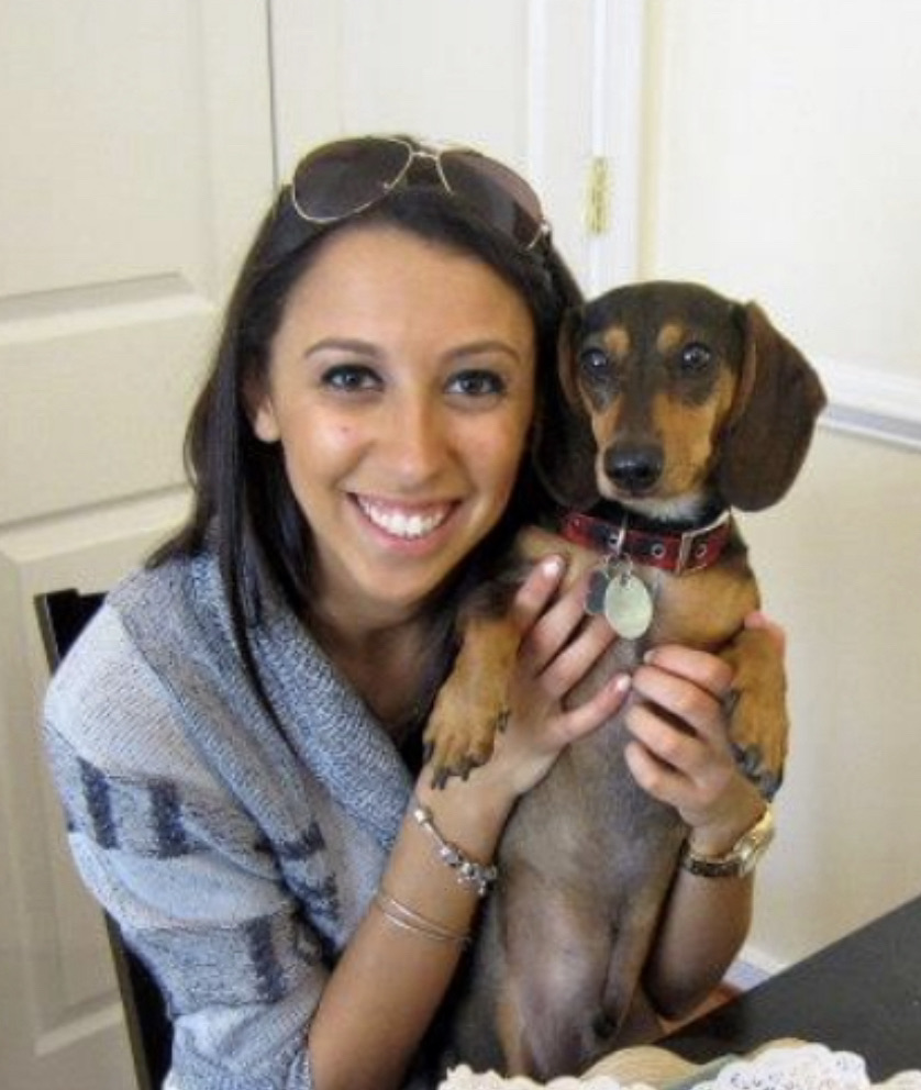 woman holding a dachsund