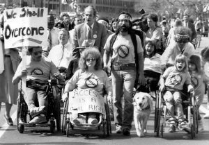 a group of disabled protesters from the disability rights movement