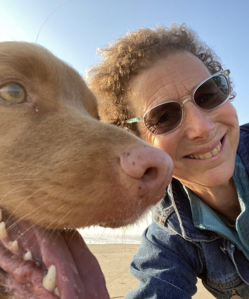 a selfie of service dog trainer Lori and her dog Chopa